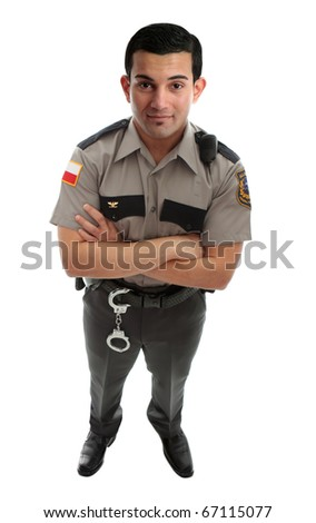 A male prison guard warden or policeman in uniform with duty belt and radio unit.   Standing with arms crossed and looking up.  White background - stock photo