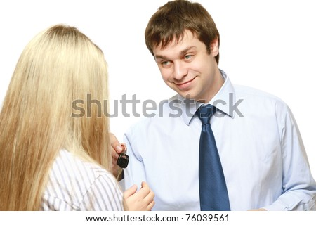 A male realtor giving keys to a woman - stock photo