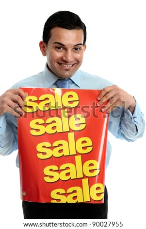 A male salesman holding a sale sign and smiling. - stock photo