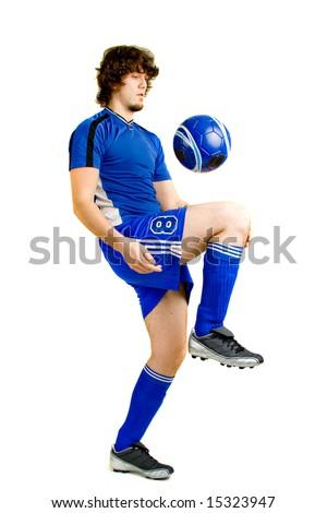 A male soccer player. Studio shot over white. - stock photo