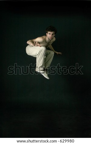 A male startled and jumping - stock photo