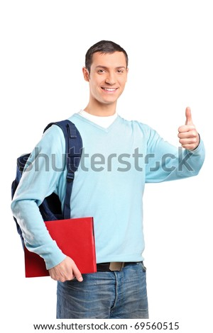 A male student holding a book and giving thumb up isolated on white background - stock photo