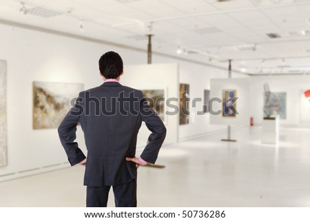 A male Visitor in museum - stock photo