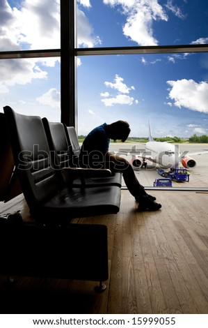 A male waiting sleeping in the airport - stock photo