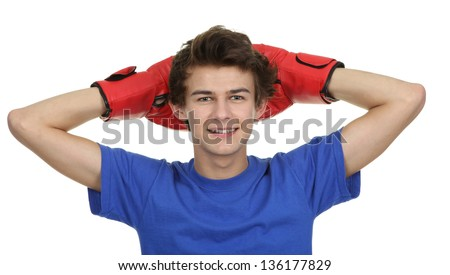A male wearing boxing gloves behind his head, isolated on white.