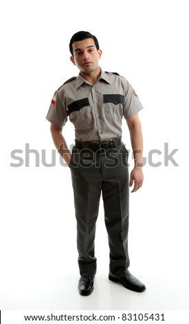 A male worker wearing uniform is standing with one hand in pocket on a white background - stock photo