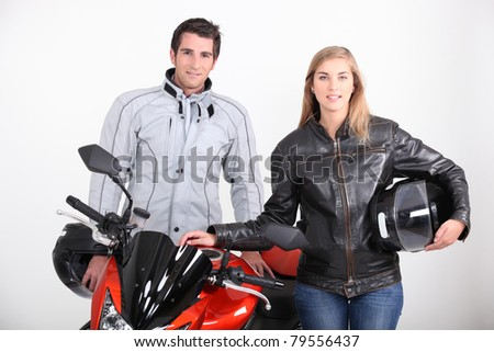 A man, a woman and a motorbike. - stock photo
