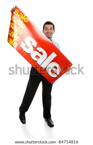 A man about to hang up a large Sale banner sign.  Suitable for many uses, retail, Christmas,clearance, etc.  Focus to the sign. - stock photo