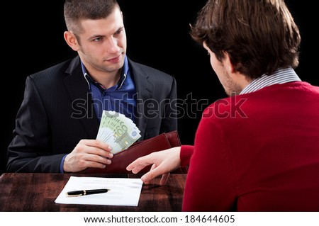 A man and a banker in the process od giving a cash loan - stock photo