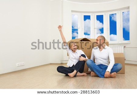 A man and a woman are happy with their new flat - stock photo