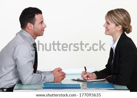 A man and a woman during an interview. - stock photo