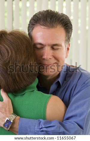 A man and a woman in embracing one another. - stock photo