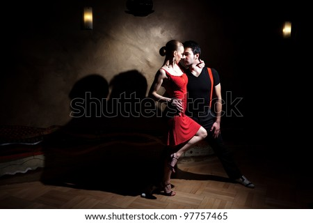 A man and a woman in the most romantic dance: tango. Please see more images from the same shoot. - stock photo