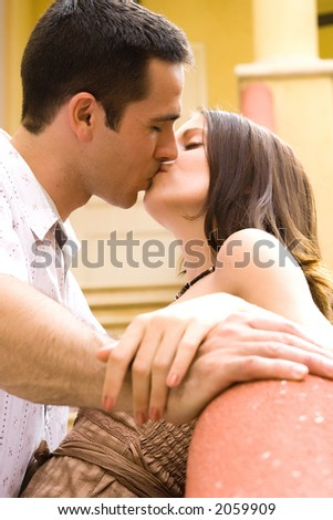 A man and a woman kissing - stock photo