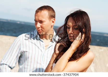 A man and a woman on a pier - stock photo