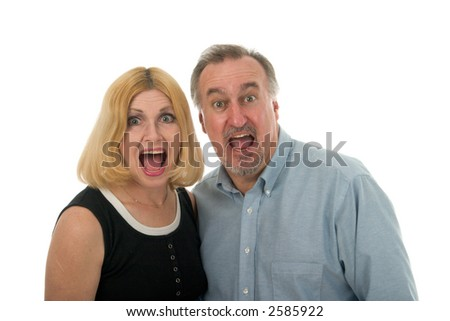A man and a woman screaming at the camera. - stock photo