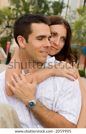 A man and a woman sitting - stock photo
