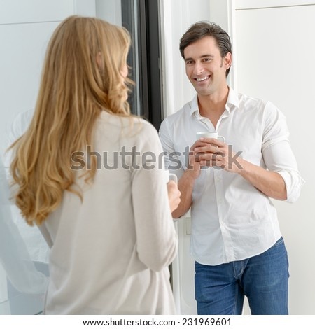A man and a woman talking in a coffee break - stock photo
