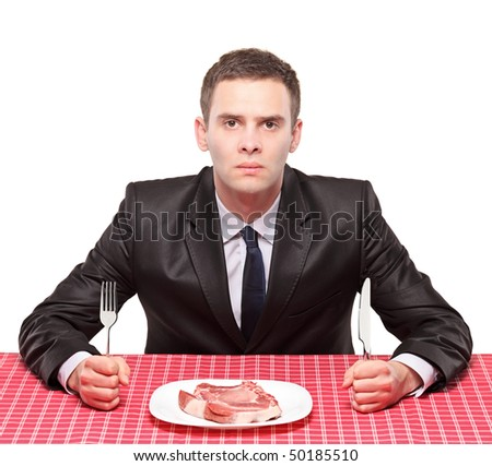 A man and an uncooked beef in a dish - stock photo