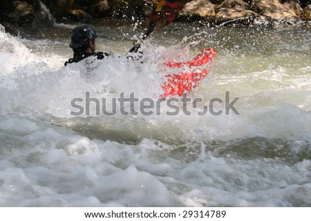 A man and kayak are swallowed up in whitewater