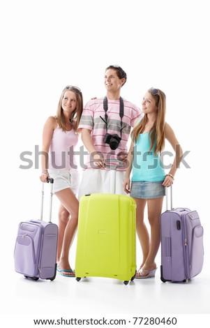 A man and two girls with their suitcases on a white background - stock photo