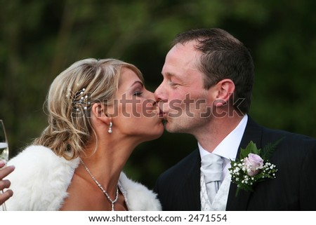 A man and wife kissing on their wedding day