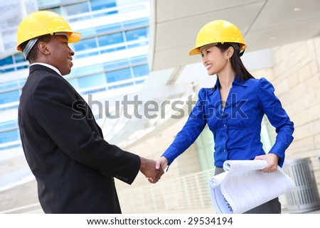 A man and woman architect on a construction site - stock photo