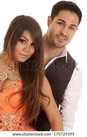 A man and woman are standing together in their formal best. - stock photo