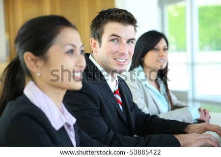A man and woman business group at meeting in office building - stock photo