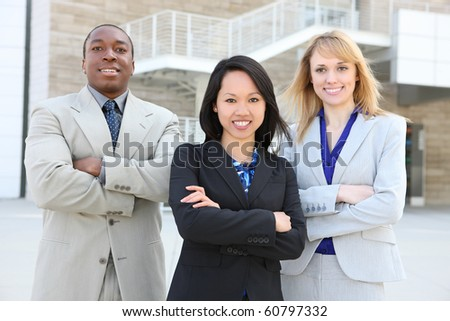 A man and woman business team at office representing diversity (Focus on middle woman)