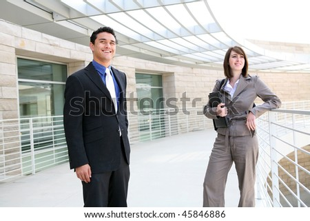 A man and woman business team at their company building - stock photo