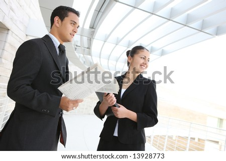 A man and woman business team at their company office building - stock photo