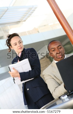 A man and woman business team working on the computer - stock photo