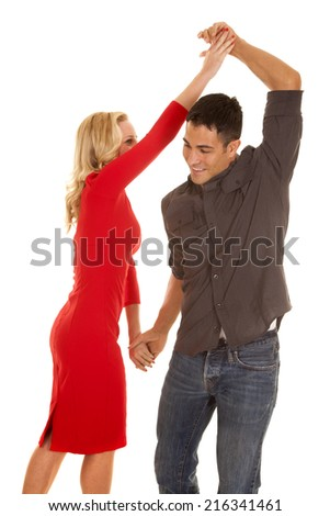 a man and woman dancing together, laughing and having fun. - stock photo