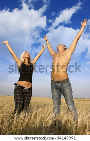 a man and woman enjoy in the field