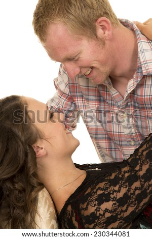 A man and woman getting close to each other with smiles on their faces. - stock photo