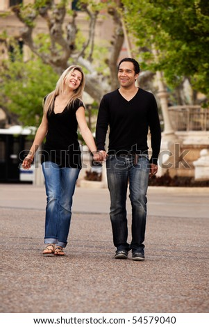 A man and woman in an urban setting in France - stock photo