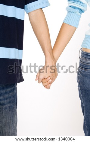 A man and woman in casual clothing holding hands