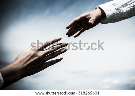A man and woman shaking hands - stock photo