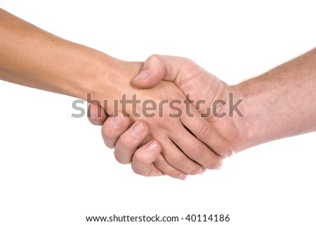 A man and woman shaking hands in agreement, with clasped hands. - stock photo