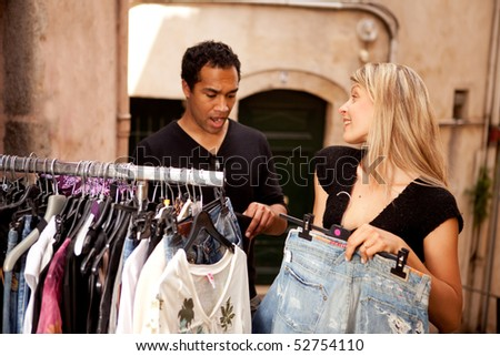 A man and woman shopping, going over the budget - shallow depth of field, focus on woman. - stock photo