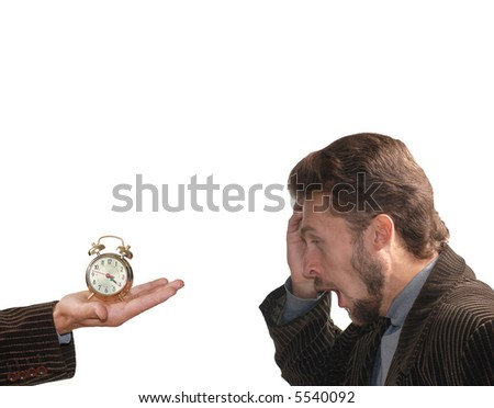 A man angry with an alarm clock