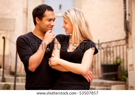 A man asking a question to a woman - stock photo