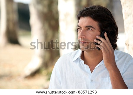 a man at phone in nature