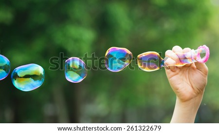 a man Blowing soap bubbles - stock photo