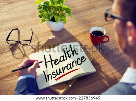 A Man Brainstorming with Health Insurance - stock photo