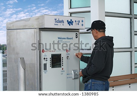 A man buying a ticket for the train - stock photo