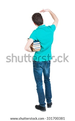 A man carries a heavy pile of books and waves . back view. Rear view people collection.  backside view of person.  Isolated over white background.  - stock photo
