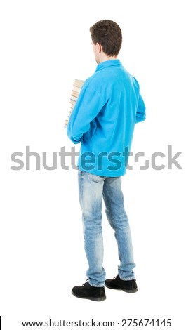 A man carries a heavy pile of books. back view. Rear view people collection.  backside view of person.  Isolated over white background. Thoughtfully is a student with books.