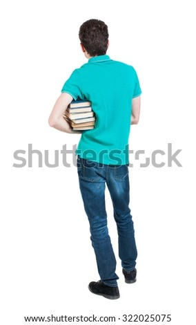 A man carries a heavy pile of books. back view. Rear view people collection.  backside view of person.  Isolated over white background. Man holding a heavy stack of books under his right armpit. - stock photo